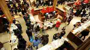 """People crowd the aisles inside Macy's department store Nov. 25, 2011, in New York after the midnight opening to begin the """"Black Friday"""" shopping weekend."""