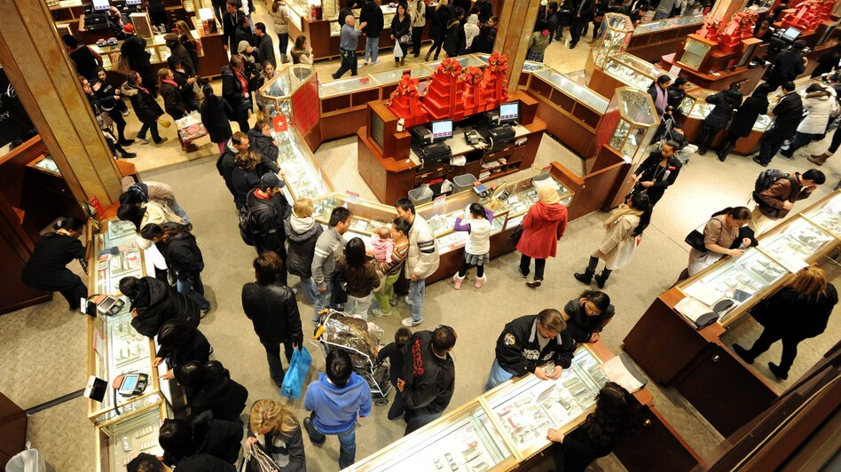 "People crowd the aisles inside Macy's department store Nov. 25, 2011, in New York after the midnight opening to begin the ""Black Friday"" shopping weekend. (AFP/Getty Images)"