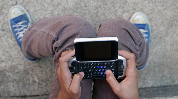 As more teens get mobile devices, parents are using apps to track their every tweet and post. (iStockphoto.com)