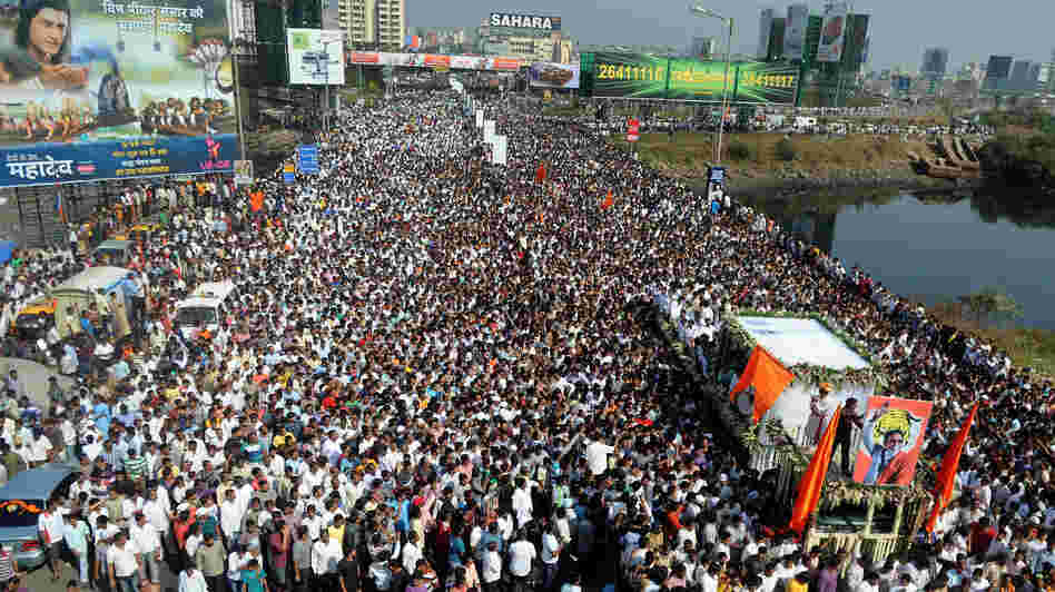 Bal Thackeray's funeral cortege made its way through a sea of supporters in Mumbai on Sunday.