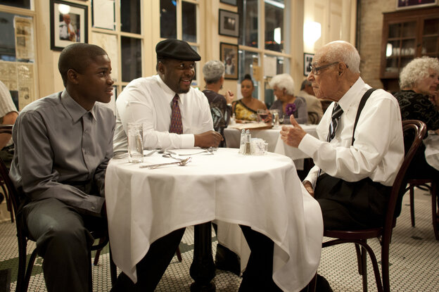 Antoine Batiste (Wendell Pierce) and his student Robert (Jaron Williams) take a minute with trumpeter Lionel Ferbos, playing himself, at the Palm Court Jazz Cafe.