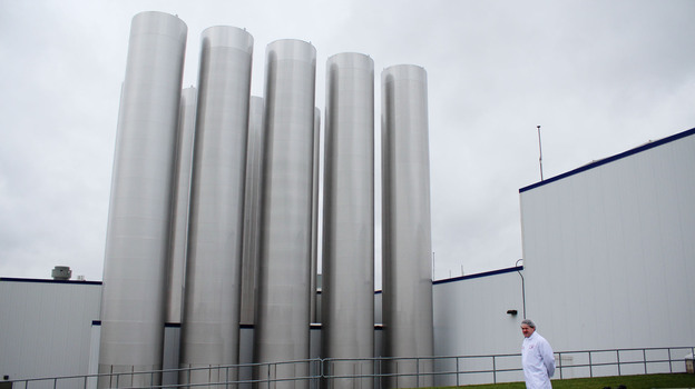 Most of the gleaming steel tanks outside Fage's yogurt factory hold milk. One, however, holds the yogurt byproduct whey. (NPR)