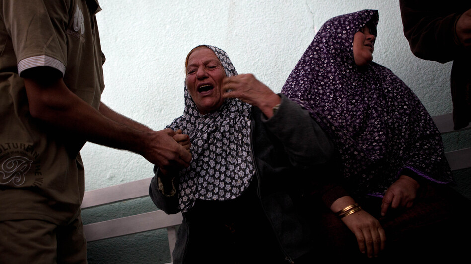Palestinians react after they checked the body of their family member killed in an Israeli air strike, at Al-Adwan Hospital in Gaza City on Tuesday. (Xinhua /Landov)