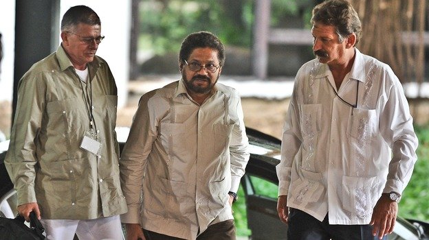 Colombian members of FARC, commanders Ivan Marquez, center, and Rodrigo Granda, left, arrive at Convention Palace in Havana for the peace talks with the Colombian government on Monday. (AFP/Getty Images)
