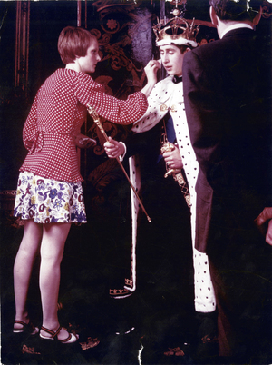 Coddington helps Prince Charles prepare for his official investiture photograph at Windsor Castle in 1969.