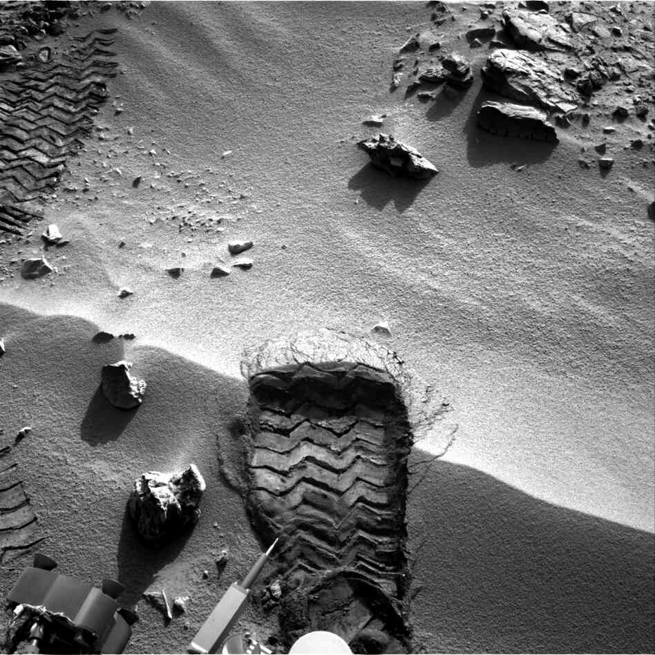 "NASA's Mars rover Curiosity cut a wheel scuff mark into a wind-formed ripple at the ""Rocknest"" site to give researchers a better opportunity to examine the particle-size distribution of the material forming the ripple. The rover's right Navigation camera took this image of the scuff mark on the mission's 57th"