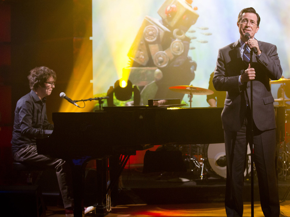 Stephen Colbert (right) performs with Ben Folds on the set of his TV show, <em>The Colbert Report</em>.
