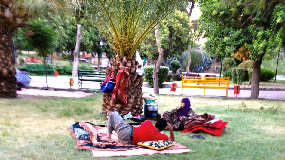 Syrians whose homes have been destroyed by recent shelling sleep in a Damascus park. (Courtesy)