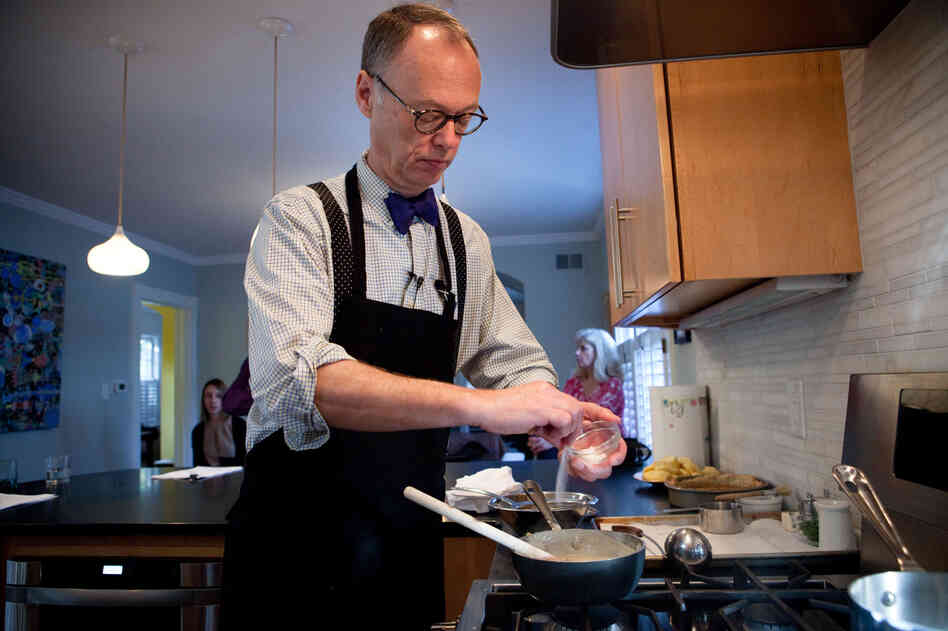 Chris Kimball of America's Test Kitchen adds salt to the roux he's made to add to Julia Child's Puree De Pommes De Terre A L'Ail, or Garlic Mashed Potatoes.
