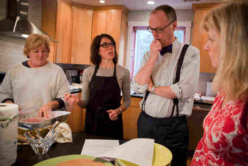 It takes a village to make a Thanksgiving radio segment. From left, assistant Carolyn Robb Schimley, Cherkasky, Kimball and publicist Deb Broide go over the plan for creating a Julia Child Thanksgiving on the radio.