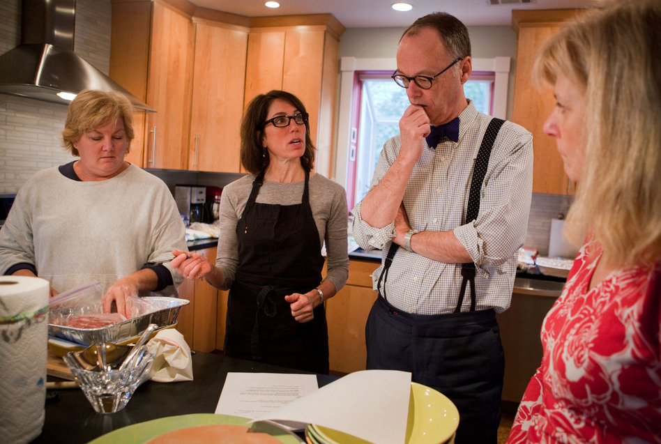 It takes a village to make a Thanksgiving radio segment. From left, assistant Carolyn Robb Schimley, Cherkasky, Kimball and publicist Deb Broide go over the plan for creating a Julia Child Thanksgiving on the radio. (Maggie Starbard/NPR)