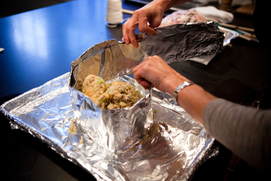 Putting a foil collar around the stuffing creates a base for the turkey breast to rest on and allows both the stuffing and the meat to cook up moist and juicy. (Maggie Starbard/NPR)