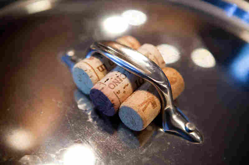 Kitchen tip: Corks make a great handle if you don't want to mess with potholders or dishtowels.