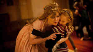 "Mary Alice LeGrow, otherwise known as ""Princess Marty,"" hugs a young girl during a birthday party in a Philadelphia suburb. A graphic artist and ""cosplay"" (costume play) fanatic, LeGrow became a full-time professional party princess to make ends meet during the economic downturn."