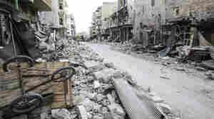 Rubble litters the street in the main souk or market area of Maraat al-Numan, Syria.