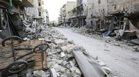 Rubble litters the street in the main souk or market area of Maraat al-Numan, Syria.