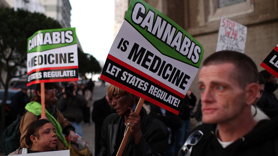 Medical marijuana advocates demonstrate outside a San Francisco fundraiser for President Obama in February. (Getty Images)