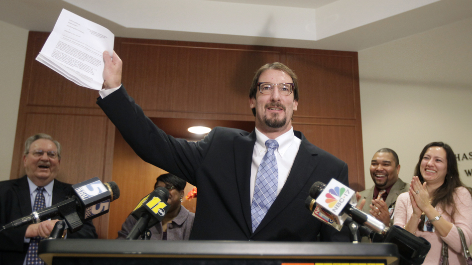 Greg Taylor holds up his release papers after he was unanimously exonerated by a three-judge panel in Raleigh, N.C., in 2010. Taylor, who had been in prison since 1993 for murder, is now suing several people who worked at a crime lab, claiming their  erroneous findings landed him in jail. (AP)