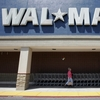 Like many other brick-and-mortar retailers, Wal-Mart is trying to attract shoppers increasingly accustomed to online shopping. In one experiment, it's offering same-day delivery in four select markets.