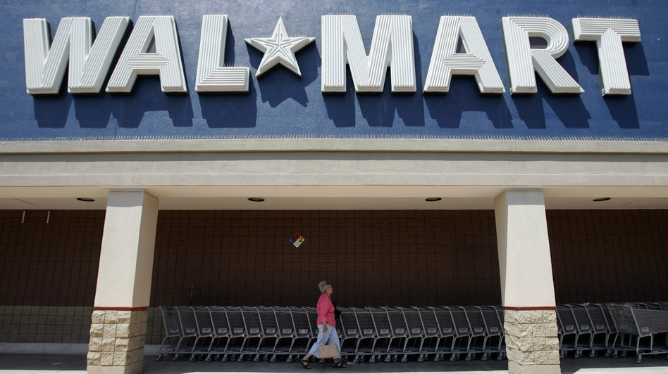 Like many other brick-and-mortar retailers, Wal-Mart is trying to attract shoppers increasingly accustomed to online shopping. In one experiment, it's offering same-day delivery in four select markets. (AP)