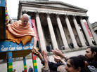 A Hare Krishna distributes food gifts from a chariot during a festival in London in 2011. The religious group began distributing books, flowers and gifts to strangers in the 1970s, drawing on the rule of reciprocation to raise money.