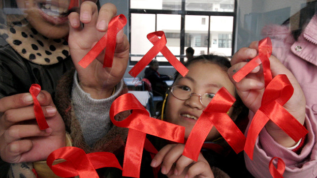 Students paste red ribbons on a window to mark World AIDS Day in Nanjing, China, in 2006. Between 2007 and 2011, the number of newly diagnosed HIV cases in China has nearly quadrupled to 40,000. (AP)