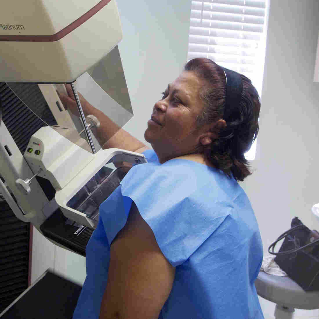 A mammographer prepares a screen-film mammography test for patient Alicia Maldonado at a hospital in Los Angeles.