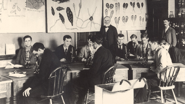 William Beal, standing at center, started a long-term study on seed germination in 1879. He buried 20 bottles with seeds in them for later researchers to unearth and plant. (Michigan State University)