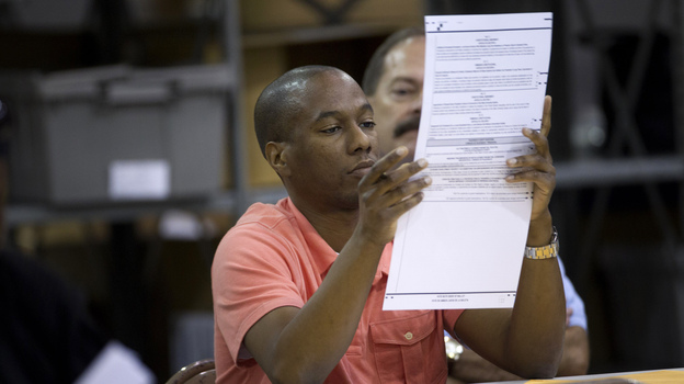 A Palm Beach County election worker counts ballots in Riviera Beach, Fla., on Nov. 9. Rep. Allen West contested the results of the election in Florida's 18th District for two weeks before conceding. Since 2000, the number of contested elections has more than doubled. (AP)