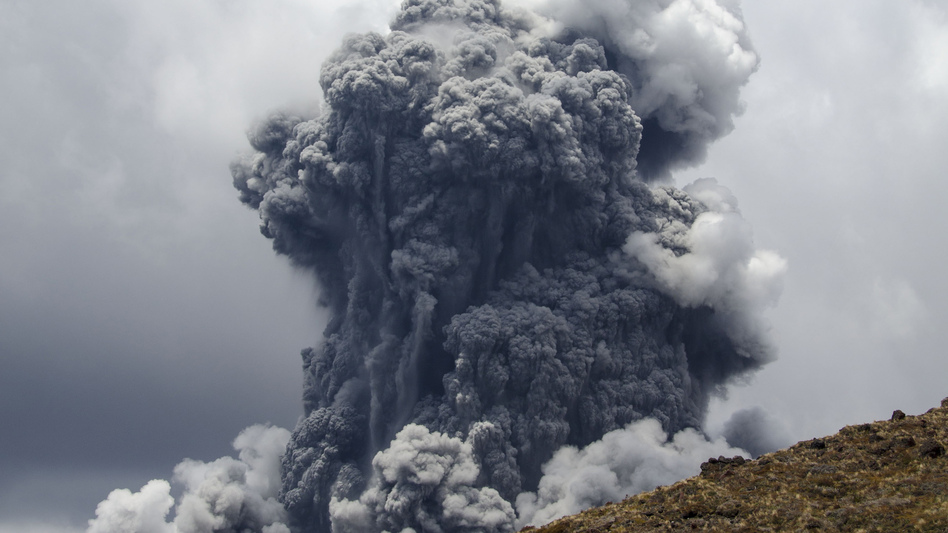 A massive plume of ash billows up into the sky as Mount Tongariro erupts at Tongariro National Park earlier today in New Zealand.
