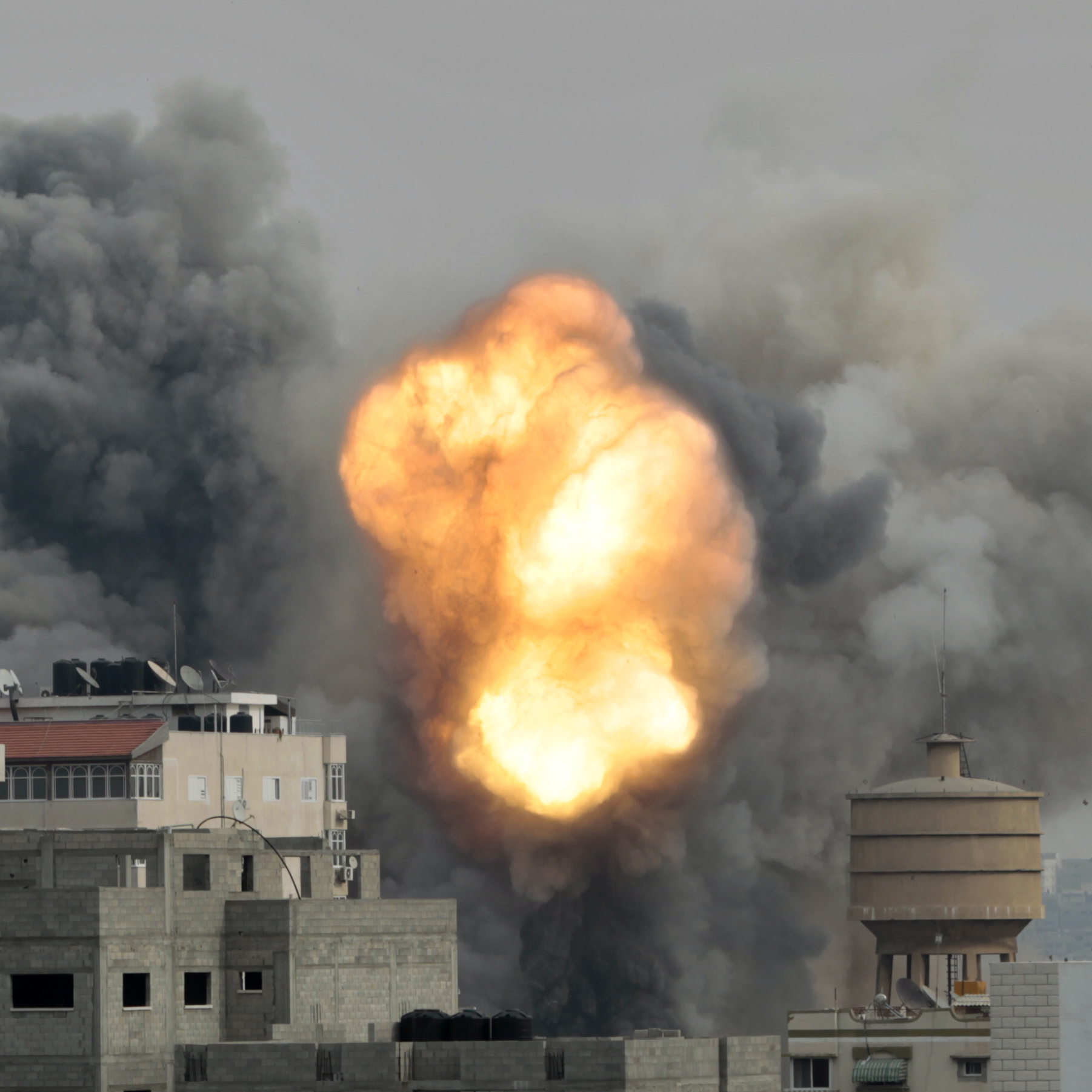 In Gaza City today, flames and smoke rise from the site hit by an air strike from Israeli forces.