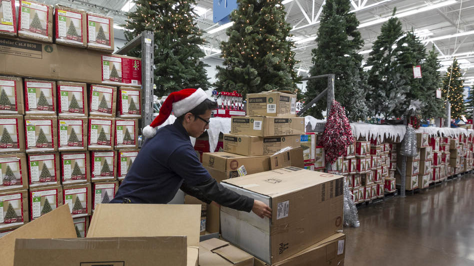 Walmart associate Angel Campos stocks Christmas decorations Wednesday ahead of the pre-Black Friday event at the Wal-Mart Supercenter store in Rosemead, Calif. (AP)