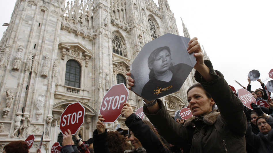 Demonstrators rally to protest violence against women in a march in Milan, Italy, in November 2009. This year, more than 100 women in Italy have been killed by their male partners. (AP)