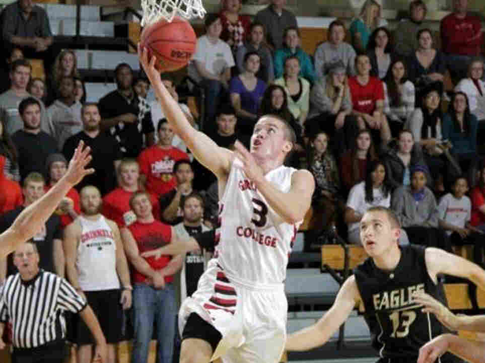 Going for the record: Grinnell College's Jack Taylor during Tuesday night's game, in which he scored 138 points.