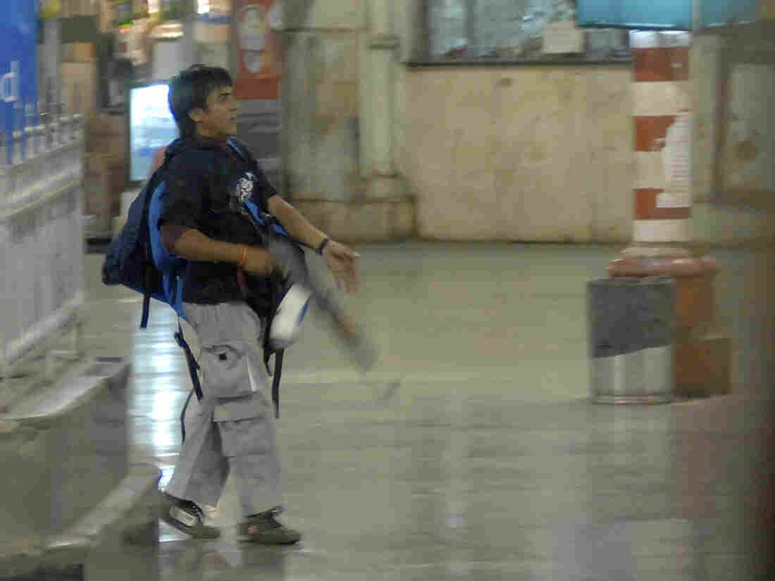 Nov. 26, 2008: Mohammed Ajmal Kasab, during the attack, in Mumbai's Chatrapathi Sivaji Terminal railway station. He was executed today.
