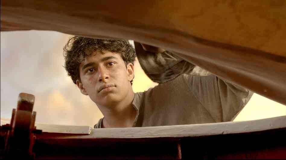 Pi Patel (Suraj Sharma) begins a journey of personal growth and spiritual discovery after being los