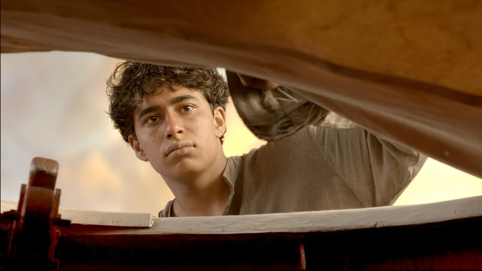 Pi Patel (Suraj Sharma) begins a journey of personal growth and spiritual discovery after being lost at sea.