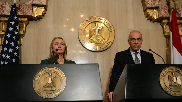"Egyptian Foreign Minister Mohammed Kamel Amr and U.S. Secretary of State Hillary Rodham Clinton announced the ""hold fire"" agreement in Cairo. (AFP/Getty Images)"