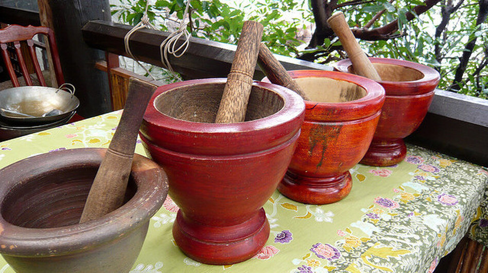 The mortar and pestle can be found in kitchens around the world, including Thailand. In the United States, chef Tanasapamon Rohman uses the tool to grind up chili paste and pulverize rice at her Thai restaurant. (Flickr)