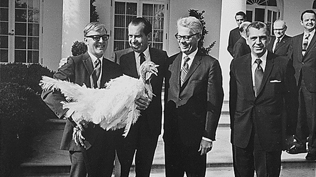 President Nixon pardons a turkey in 1969. There's quite a celebratory banquet scene in the John Adams opera, Nixon in China. (The U.S. National Archives via Flickr)