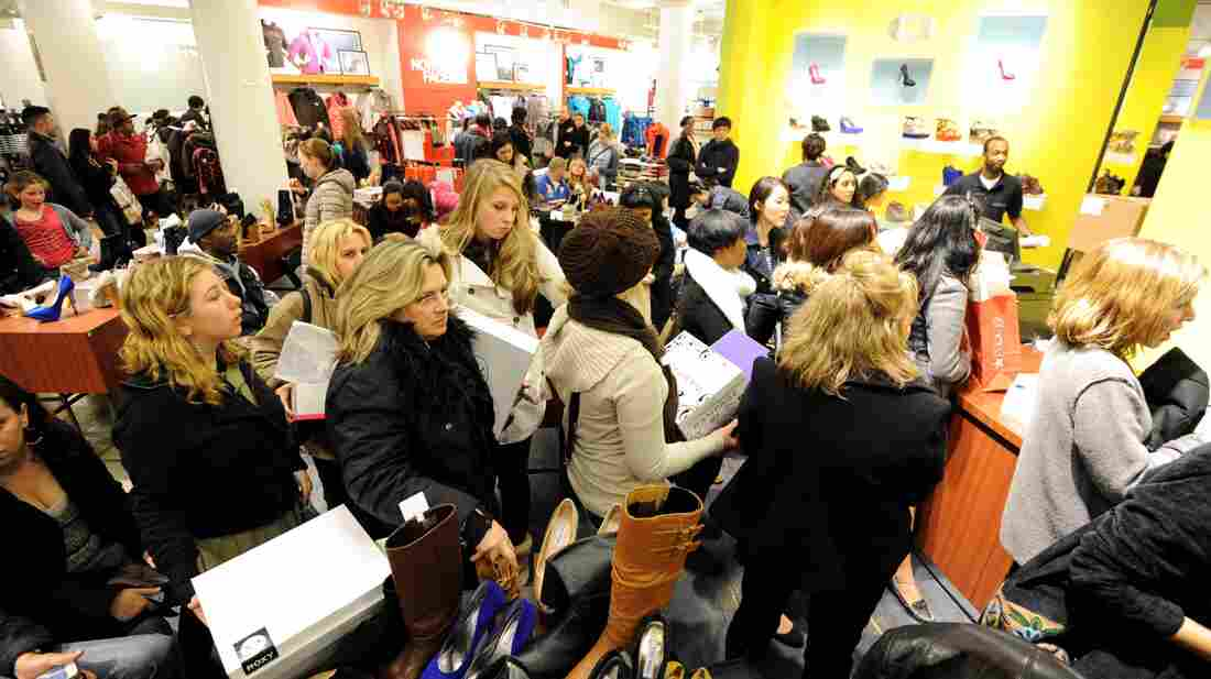 People waited in line to make purchases at a Macy's department store in New York during la