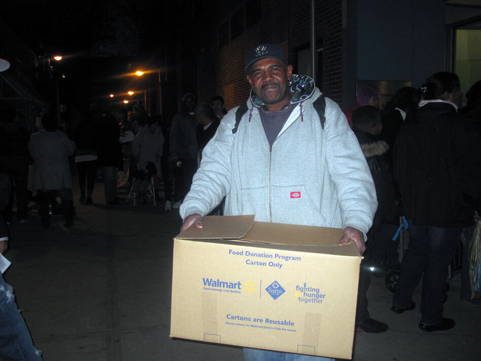 Maurice Geddie of Brooklyn's Red Hook neighborhood picks up a free turkey donated by a local grocery store. He's hoping his wife will be willing to cook it, though she's been stuck cooking for storm victims at shelters for weeks.