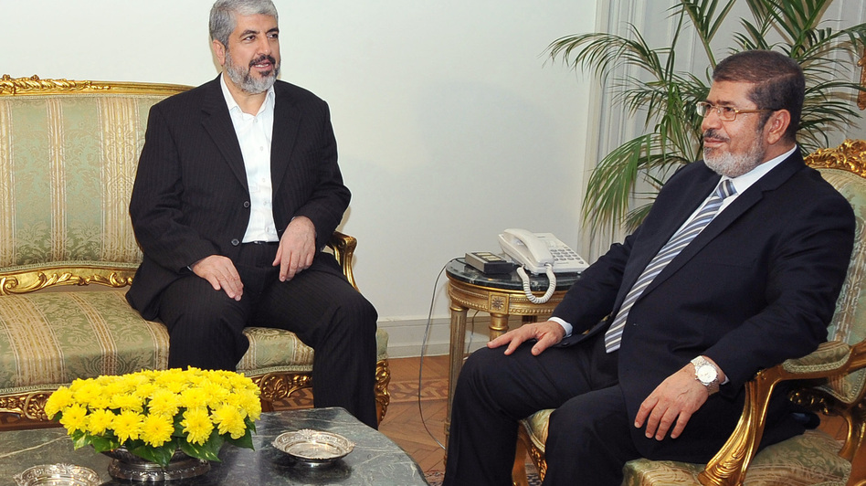 In this image provided by Egyptian President Mohammed Morsi (right), Hamas leader Khaled Mashaal meets with Morsi at the Presidential Palace in Cairo on Sunday. Morsi has won praise for brokering the cease-fire agreement between Hamas and Israel. (AP)