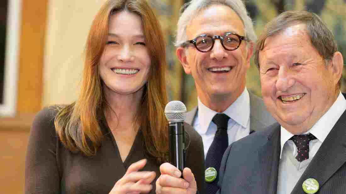 France's former first lady Carla Bruni-Sarkozy, auctioneer Francois de Ricqles and former soccer coach Guy Roux preside over the 152nd Hospices de Beaune wine auction Sunday in Beaune, France. The charity auction raised an all-time high of $7.5 million, which goes to area hospitals.