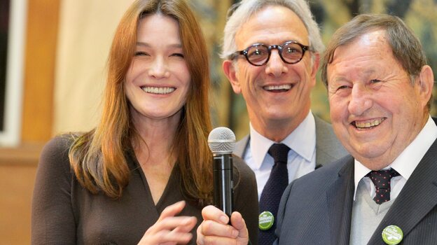 France's former first lady Carla Bruni-Sarkozy, auctioneer Francois de Ricqles and former soccer coach Guy Roux preside over the 152nd Hospices de Beaune wine auction Sunday in Beaune, France. The charity auction raised an all-time high of $7.5 million, which goes to area hospitals. (Maxppp /Landov)