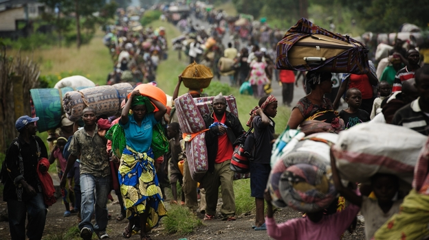To escape fighting, thousands of civilians flee the town of Sake in the eastern part of the Democratic Republic of the Congo on Thursday. Rebels captured Sake and made other advances in the area this week. Eastern Congo and the larger region have been the scene of frequent fighting over the past two decades. (AFP/Getty Images)