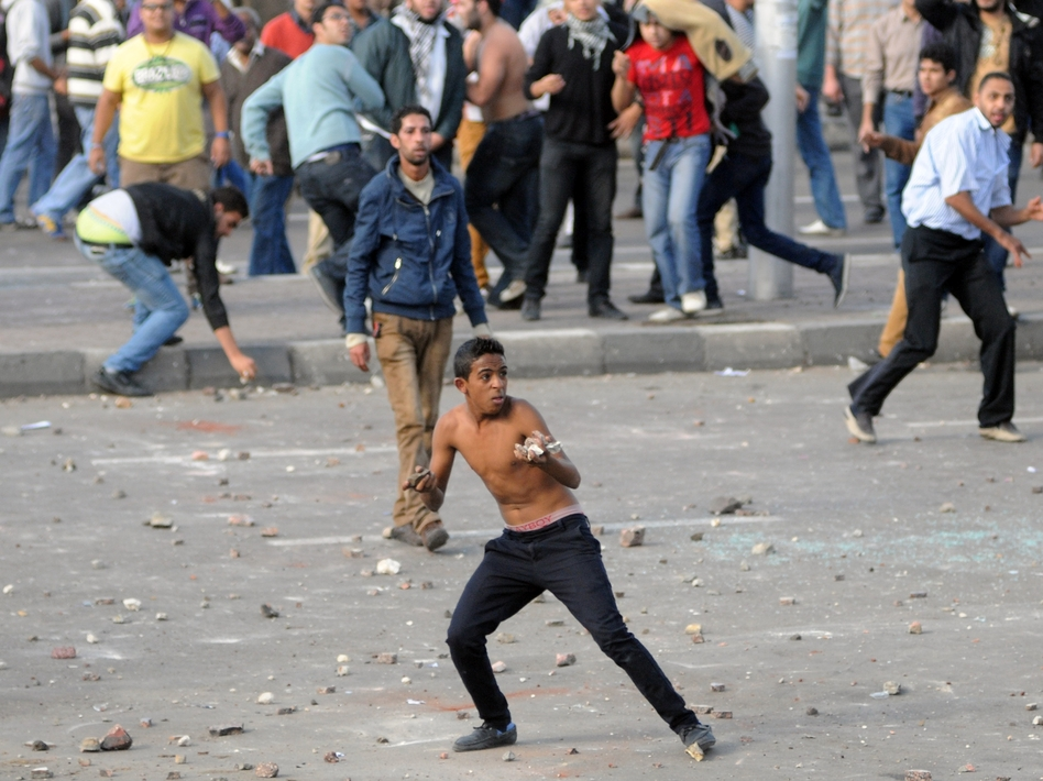 Egyptian opponents and supporters of President Mohammed Morsi clashed here in Alexandria and in other cities on Friday. The protests broke out a day after Morsi gave himself sweeping new powers. (AFP/Getty Images)