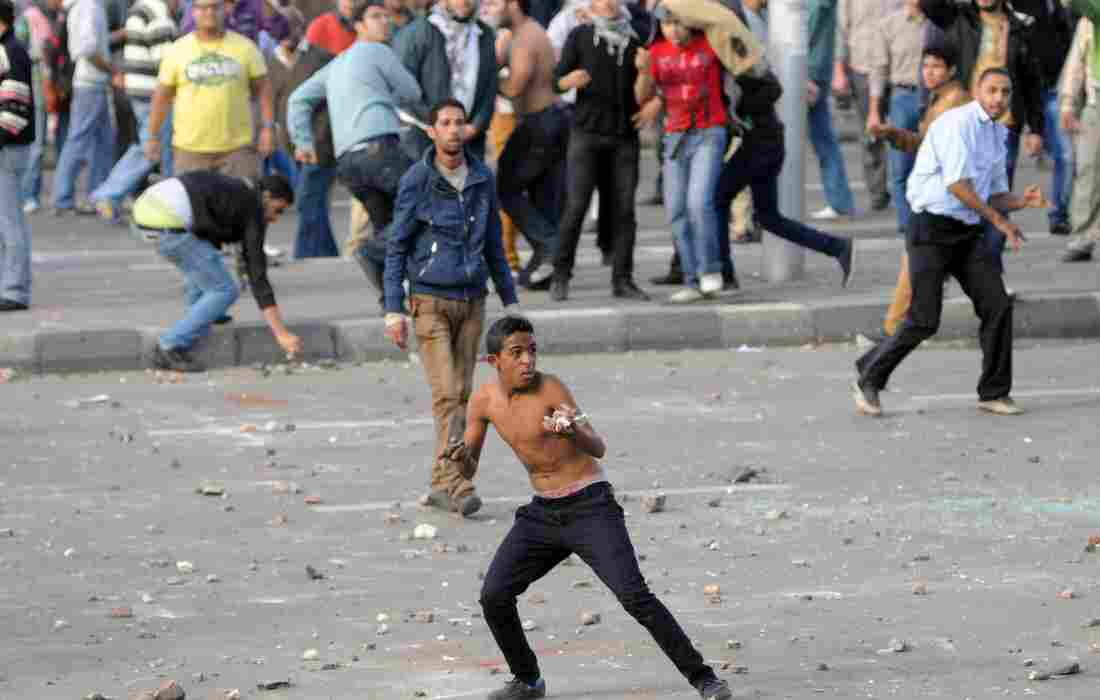 Egyptian opponents and supporters of President Mohammed Morsi clashed here in Alexandria and in other cities on Friday. The protests broke out a day after Morsi gave himself sweeping new powers.