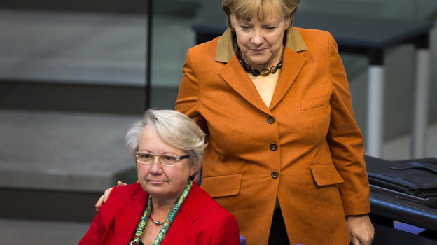 German Chancellor Angela Merkel (right) has given guarded support to Education Minister Annette Schavan, who is facing calls to resign over allegations of plagiarism. (Reuters /Landov)