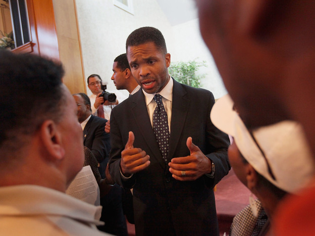 Rep. Jesse Jackson Jr. speaks to constituents in Chicago in 2009. Jackson resigned from Congress on Wednesday, following a hospitalization and an investigation into misuse of campaign funds.